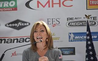 Shannon Miller speaks at Bennett driver event.