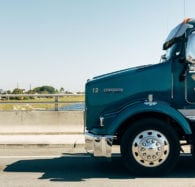 front of a kenworth truck on the road